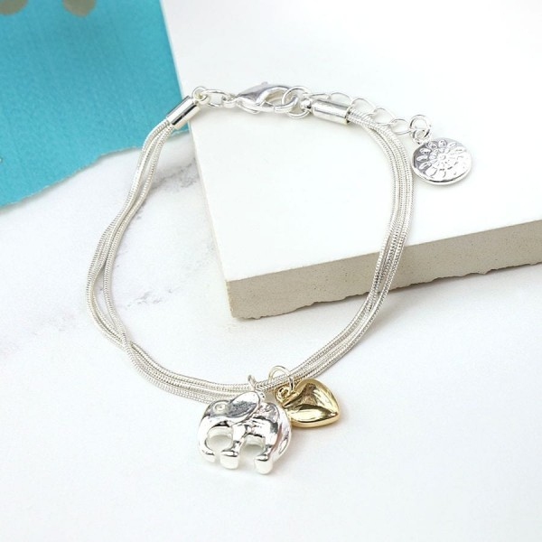 Silver plated triple strand bracelet with gold heart & silver plated elephant at Henley Circle Online Shop
