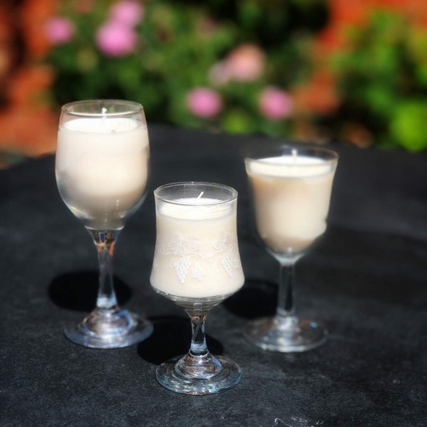 Pure white candles in vintage sherry glasses at Henley Circle Online Shop